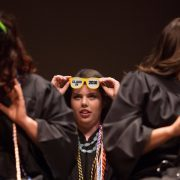 Meg Bronaugh wears 'Class of 2016' sunglasses during the Brenau University School of Nursing Pinning Ceremony on Thursday, May 5, 2016 in Pearce Auditorium in Gainesville, Ga. (AJ Reynolds/Brenau University)