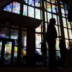 Attendees are seen in front of a stained glass window at the Wine & Cheese Opening Reception on Friday, April 15, 2016, in Gainesville, Ga. (AJ Reynolds/Brenau University)