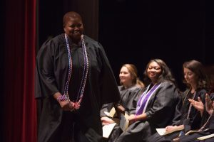Shimi Barry walks across the stage to receive and award during the Brenau University School of Nursing Pinning Ceremony on Thursday, May 5, 2016 in Pearce Auditorium in Gainesville, Ga. (AJ Reynolds/Brenau University)