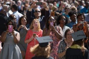 Family members and friends take photos while graduates process to the Front Lawn during The Women's College commencement on Friday, May 6, 2016, in Gainesville, Ga. (AJ Reynolds/Brenau University)