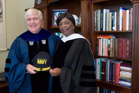 Brenau President Ed Schrader poses for a photo with retired Rear Adm. Annie Andrews, the 2016 commencement speaker, who engineered the experience of several college presidents aboard an aircraft carrier to encourage programs to recruit women into the U.S. Navy. (AJ Reynolds/Brenau University)