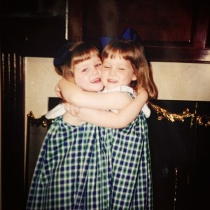 Morgan sisters hugging as young children.