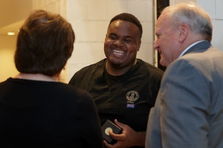 Martis Ferguson laughs while speaking with Kimberly and David Barnett during an event announcing the naming of the Brenau University Ivester College of Health Sciences. (AJ Reynolds/Brenau University)